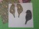 sitzende gebastelte Vögel ausgeschnitten